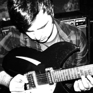 dIRECT ATTACK - Jack Champagne Holding Guitar Close-Up